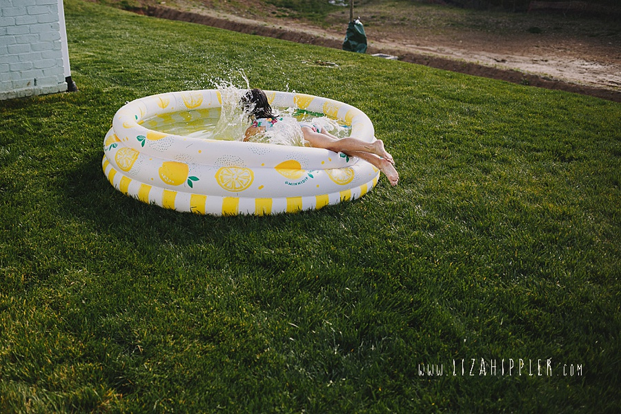 5 year old splashes in backyard pop up pool