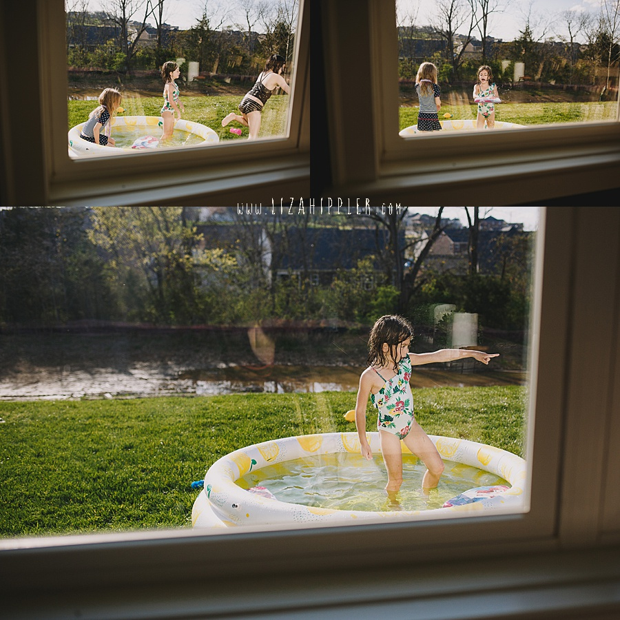 kids play in pool as seen through a window