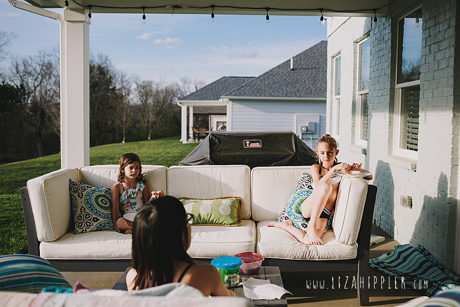 friends eating dinner on porch