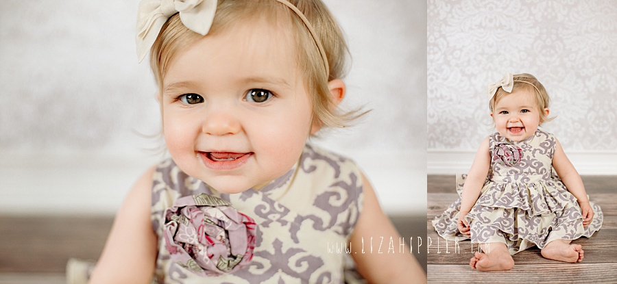 one year old girl in paisley dress
