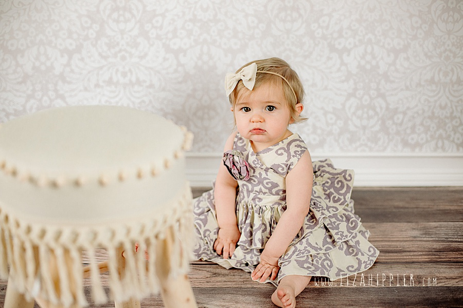 one year old baby pouts in her photoshoot