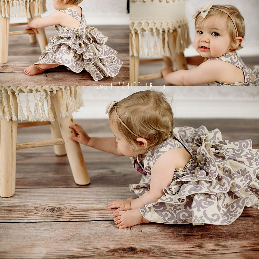 one year old baby holds onto stool