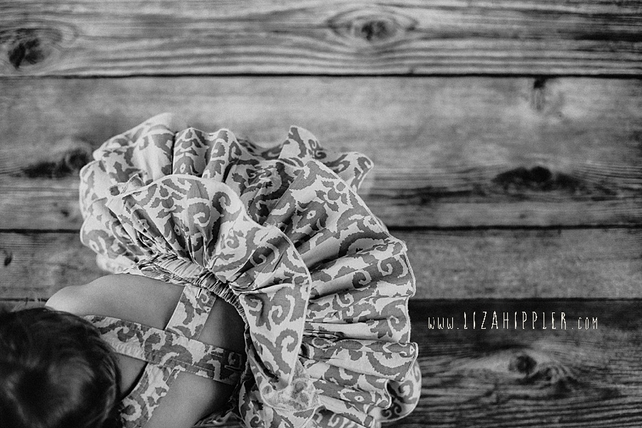 first birthday photos of girl in paisley dress