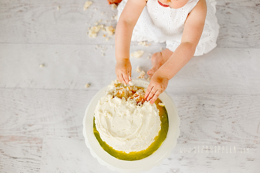 overhead shot of girl smashing cake