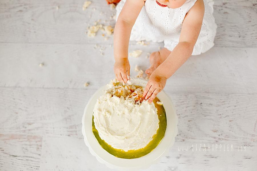 overhead shot of girl smashing cake