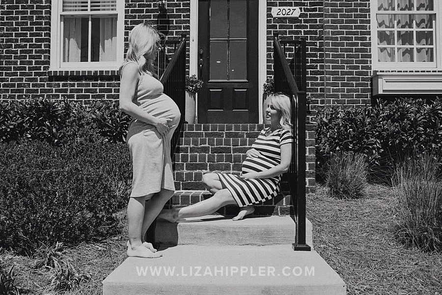 black and white image of pregnant sisters outside