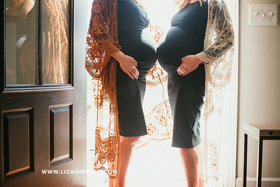 sister pregnant bellies together