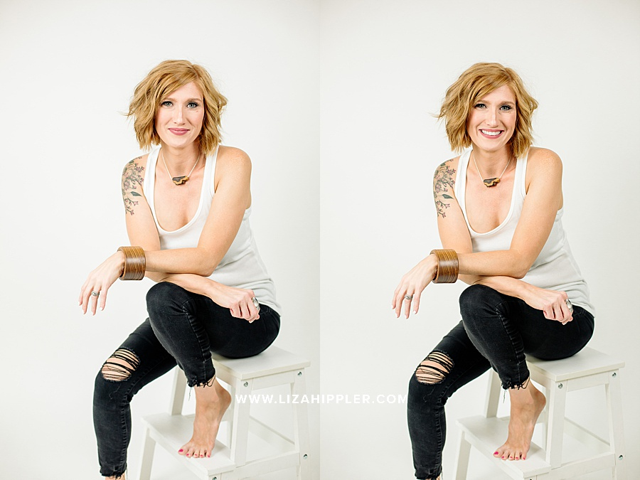 redheaded female jewelry maker poses for personal branding photos in white tank top sitting on white stool