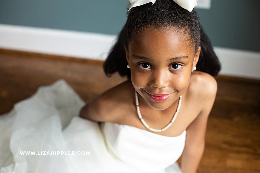 6 year old birthday girl in her mom's wedding dress
