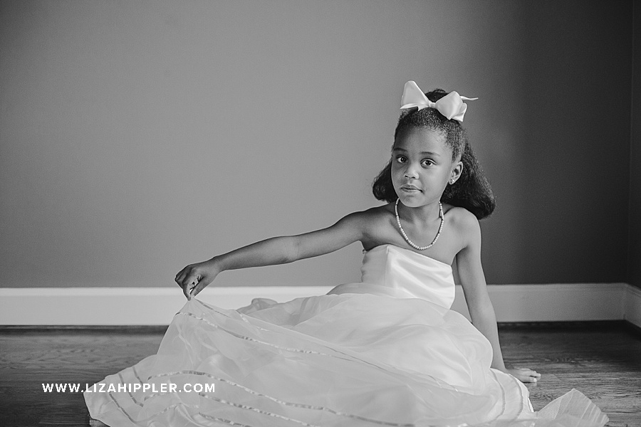 black and white photo of young african american birthday girl in mom's wedding dress sitting down