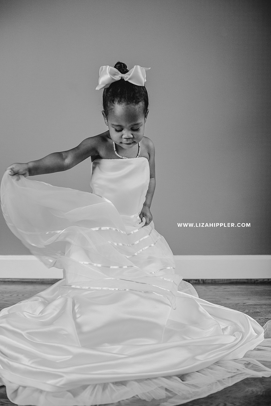 two year old spins in mom's wedding dress for her birthday