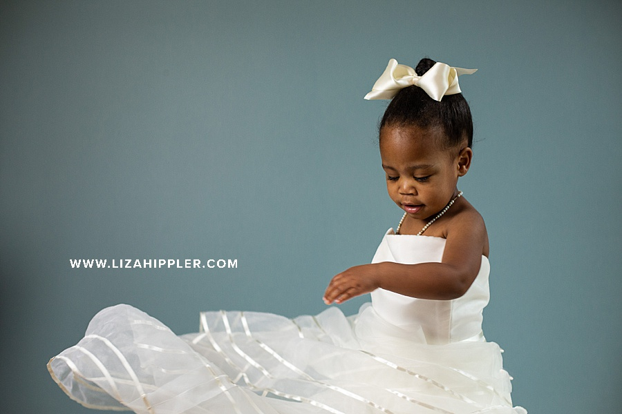 birthday photoshoot for little girl who spins in her mom's wedding dress