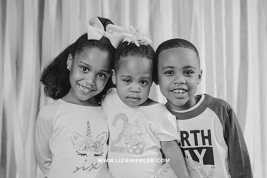 black and white images of three young siblings