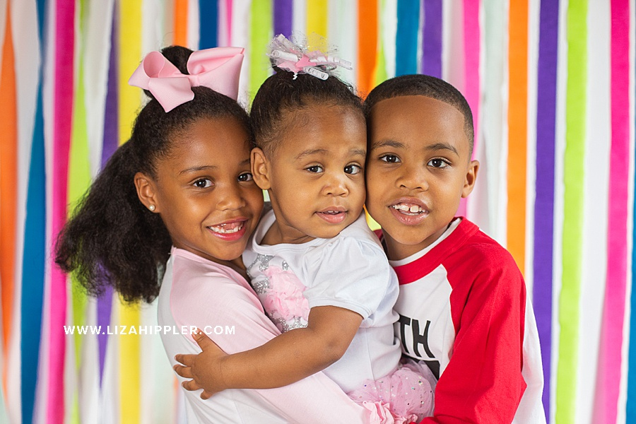photo of 2 year old, 6 year old and 7 year old siblings