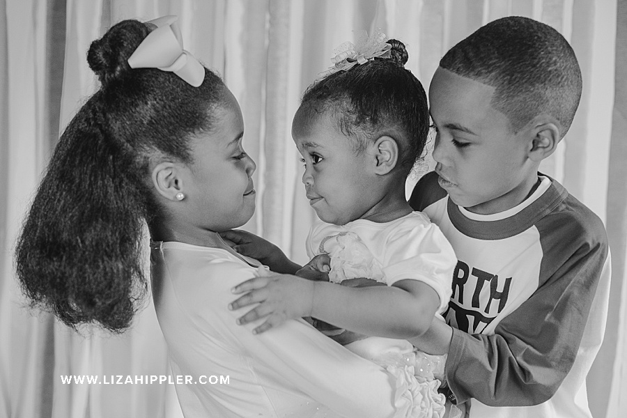 black and white photo of three young brother and sisters