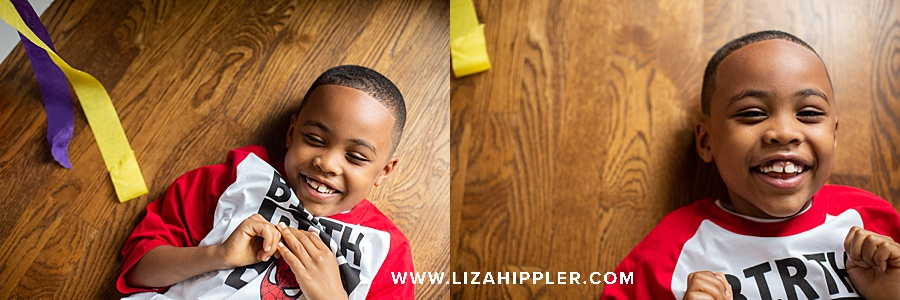 photos of 7 year old boy on the floor laughing