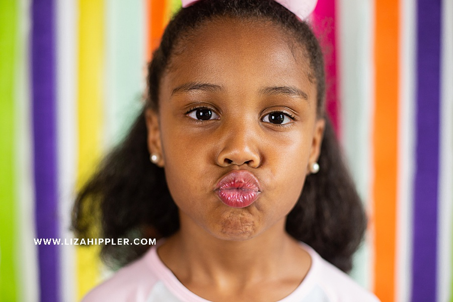 6 year old birthday girl makes a kiss face