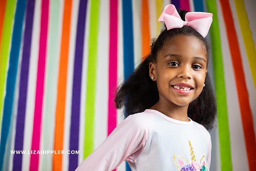 birthday girl portrait colorful backdrop