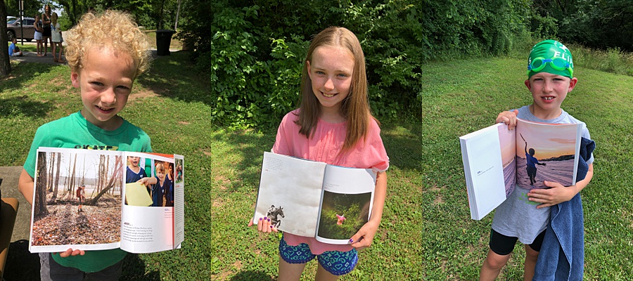 three kids hold up their favorite pages from Strong is the New Pretty