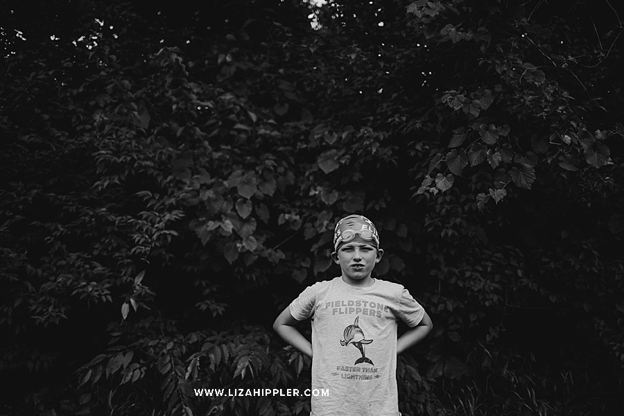 boy in swim cap in black and white