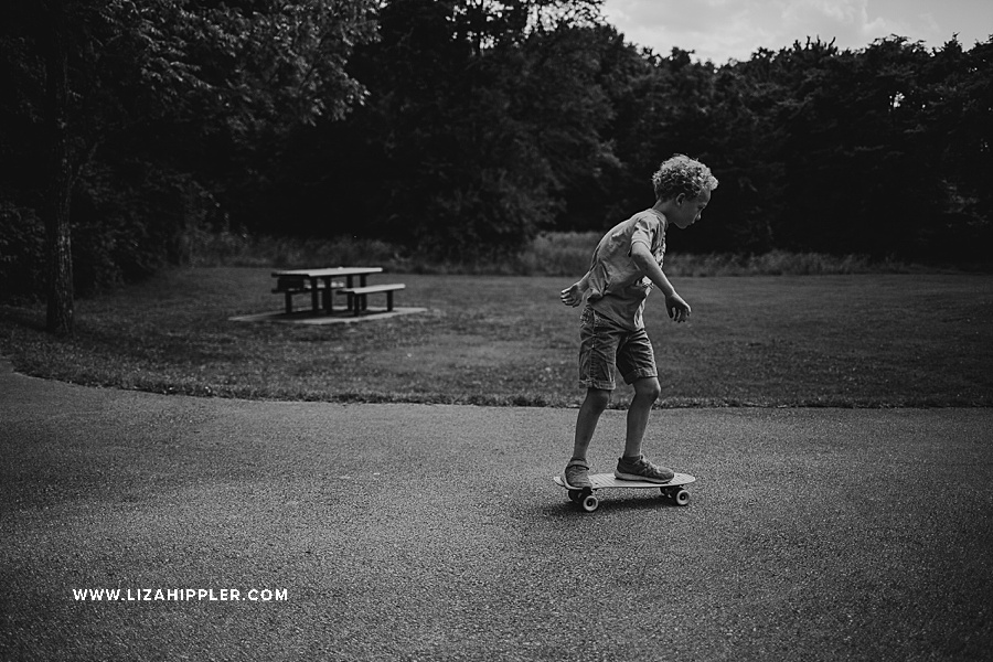 black and white of young boy skate boarding