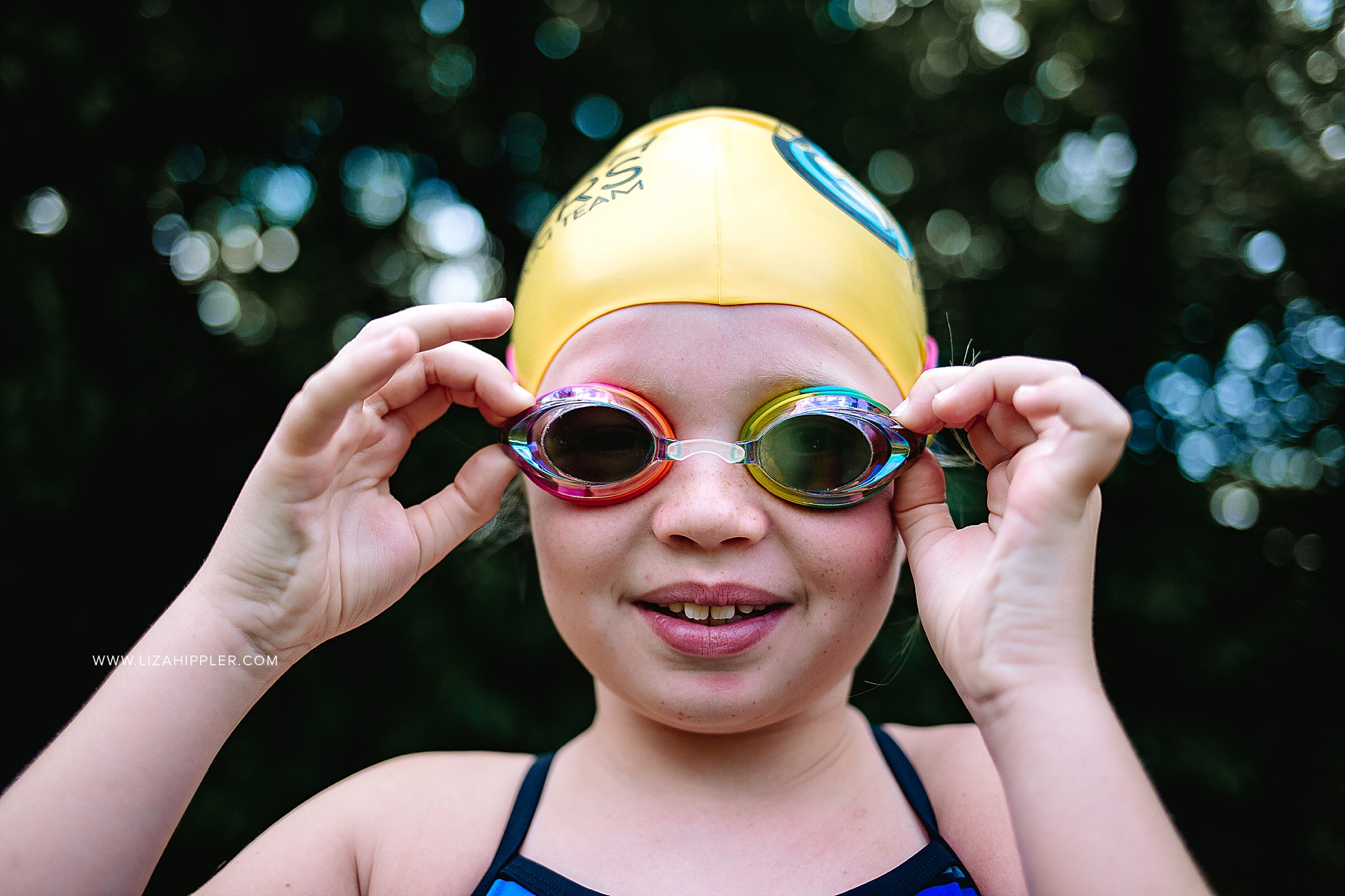 close up of girl putting on goggles