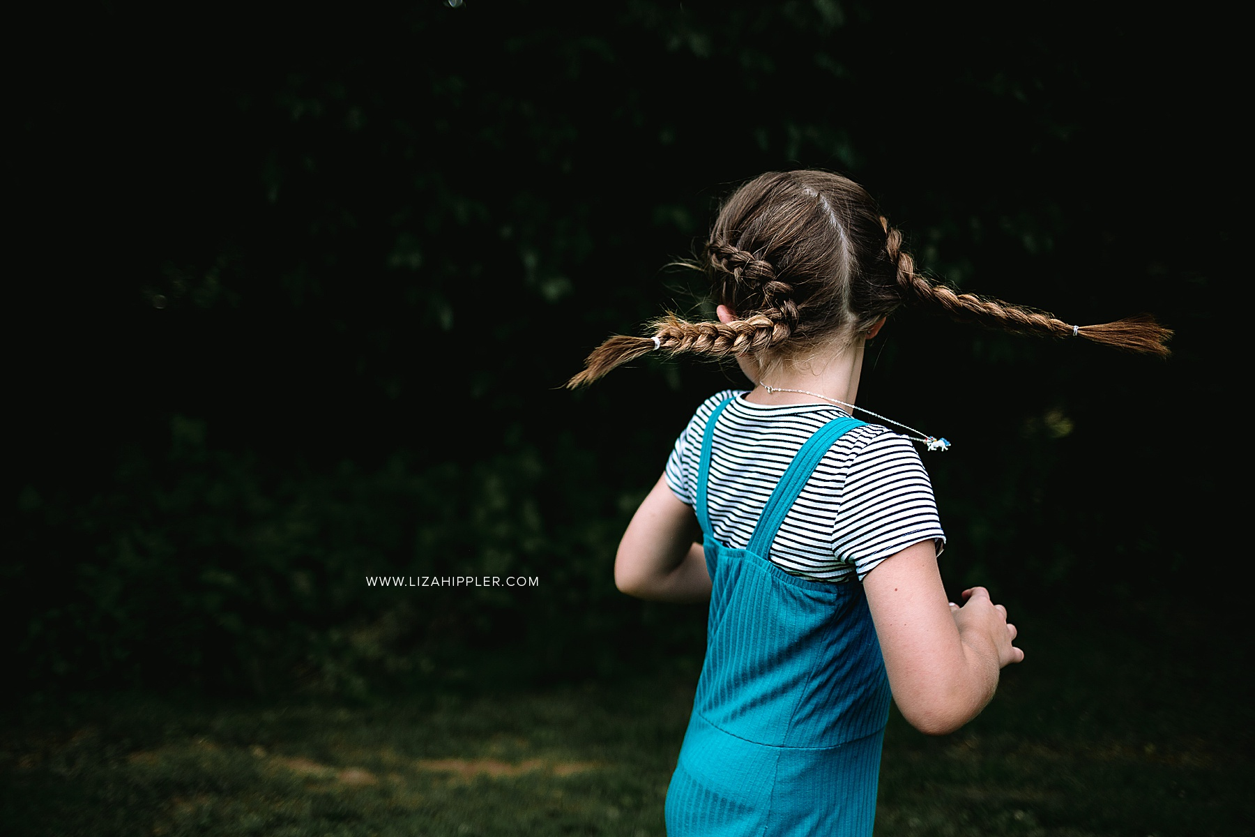 girl with double french braids spins