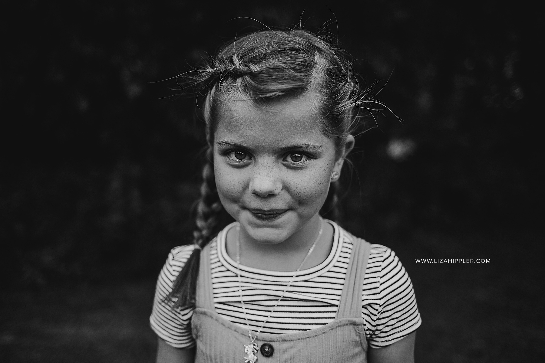 black and white close up of girl with french braids
