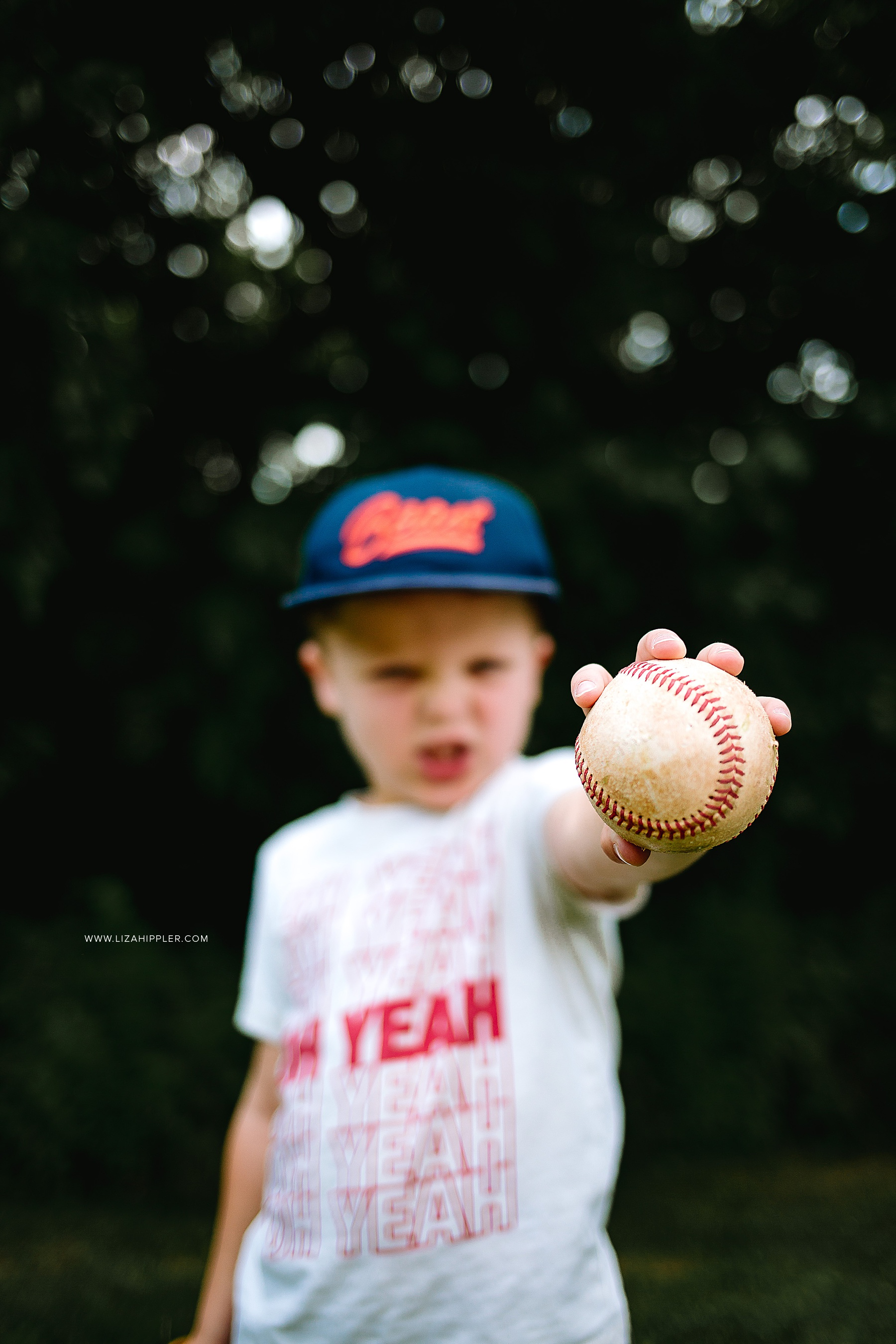 boy holds out baseball
