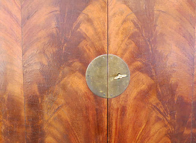 Flamed mahogany and brass detail.jpg