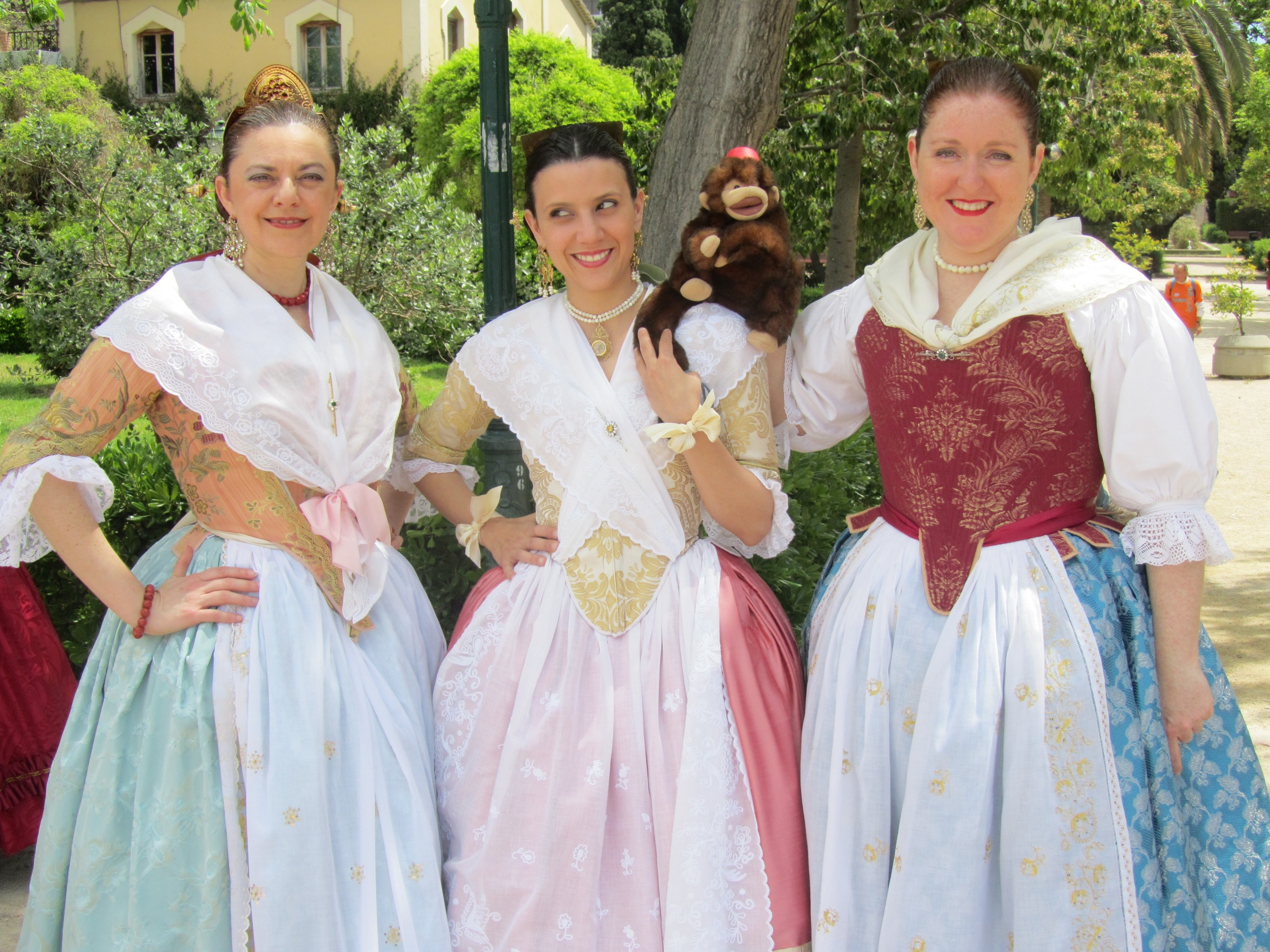 Manu the mind reading monkey in Valencia with some girls in their Falla finery.