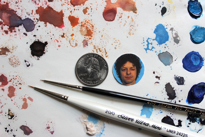 Portrait miniature shown beside a quarter for scale, along with some of my favorite brushes (Silver Ultra Mini 20/0 liner brush and Reaper Pro 40/0 sable brush) and Winsor & Newton Designers Gouache paints.