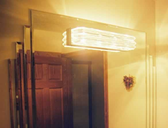 beveled_mirror_with_tiered_beveled_strips_and_light_through.jpg