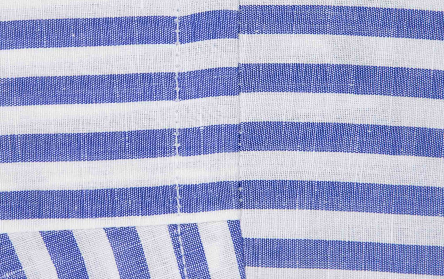 Each shirt's construction requires a 22 stitch count throughout with single needle hand sewn sleeve settings