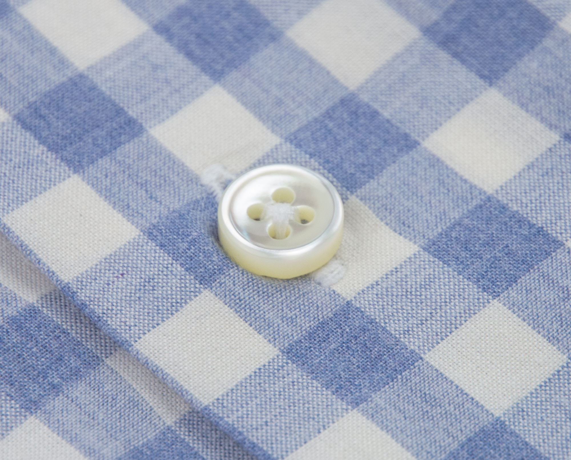 Hand crafted button holes to accommodate 3 millimeter shell buttons