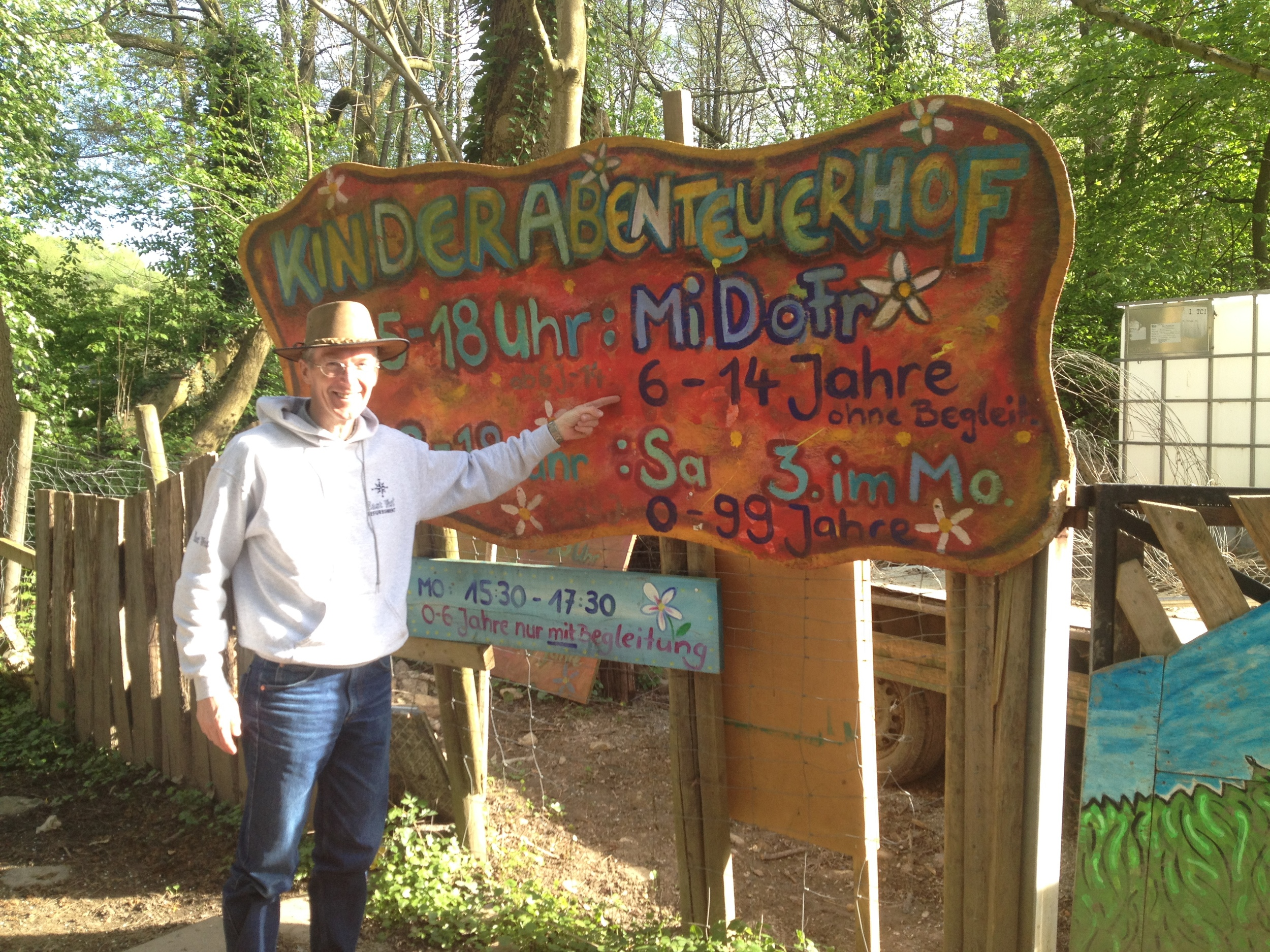Peter points out the sign marking the entrance to Kinderabenteuerhof park in Freiburg.