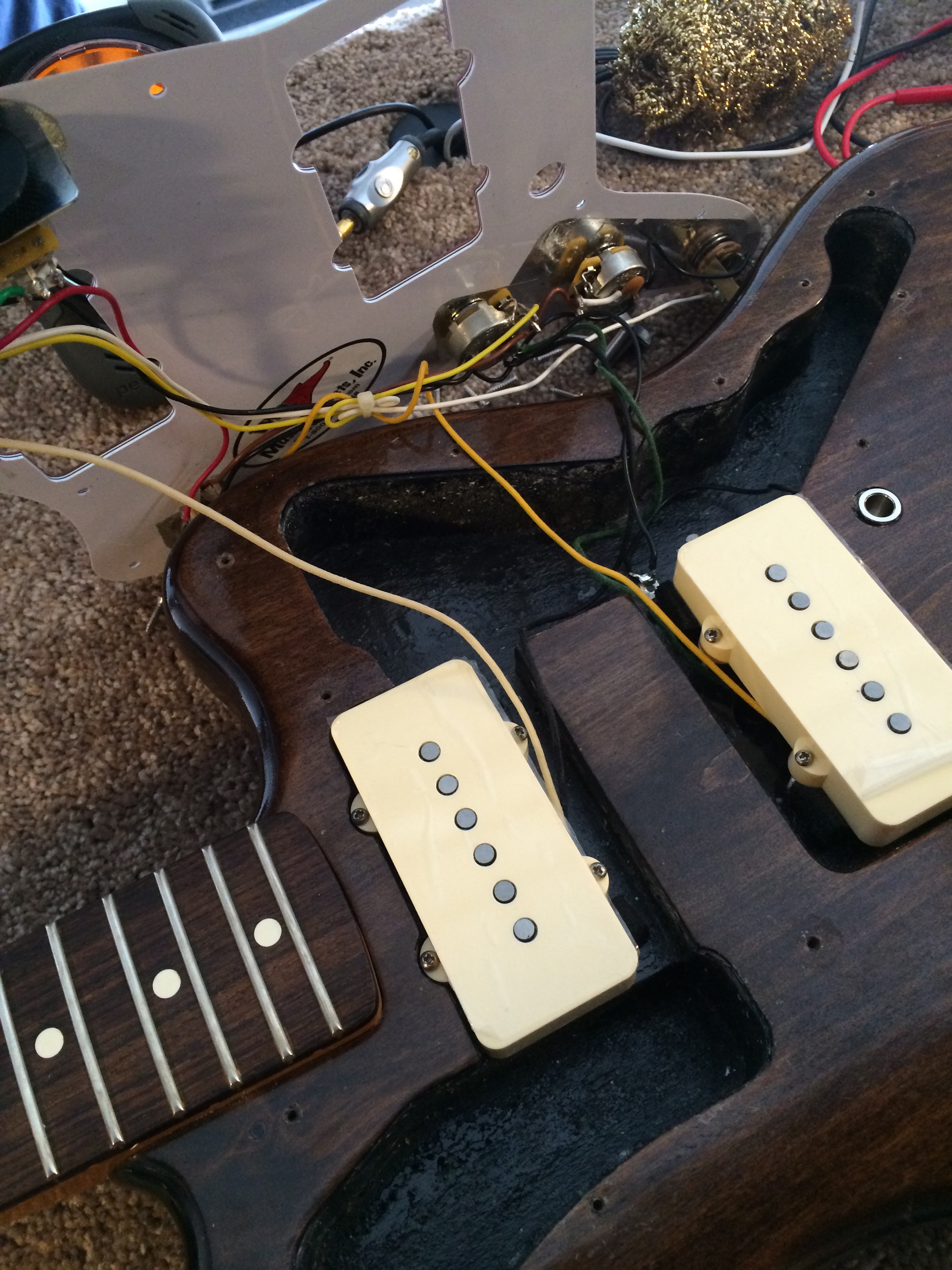 Swapping out stock pickups with new handwound Novaks!