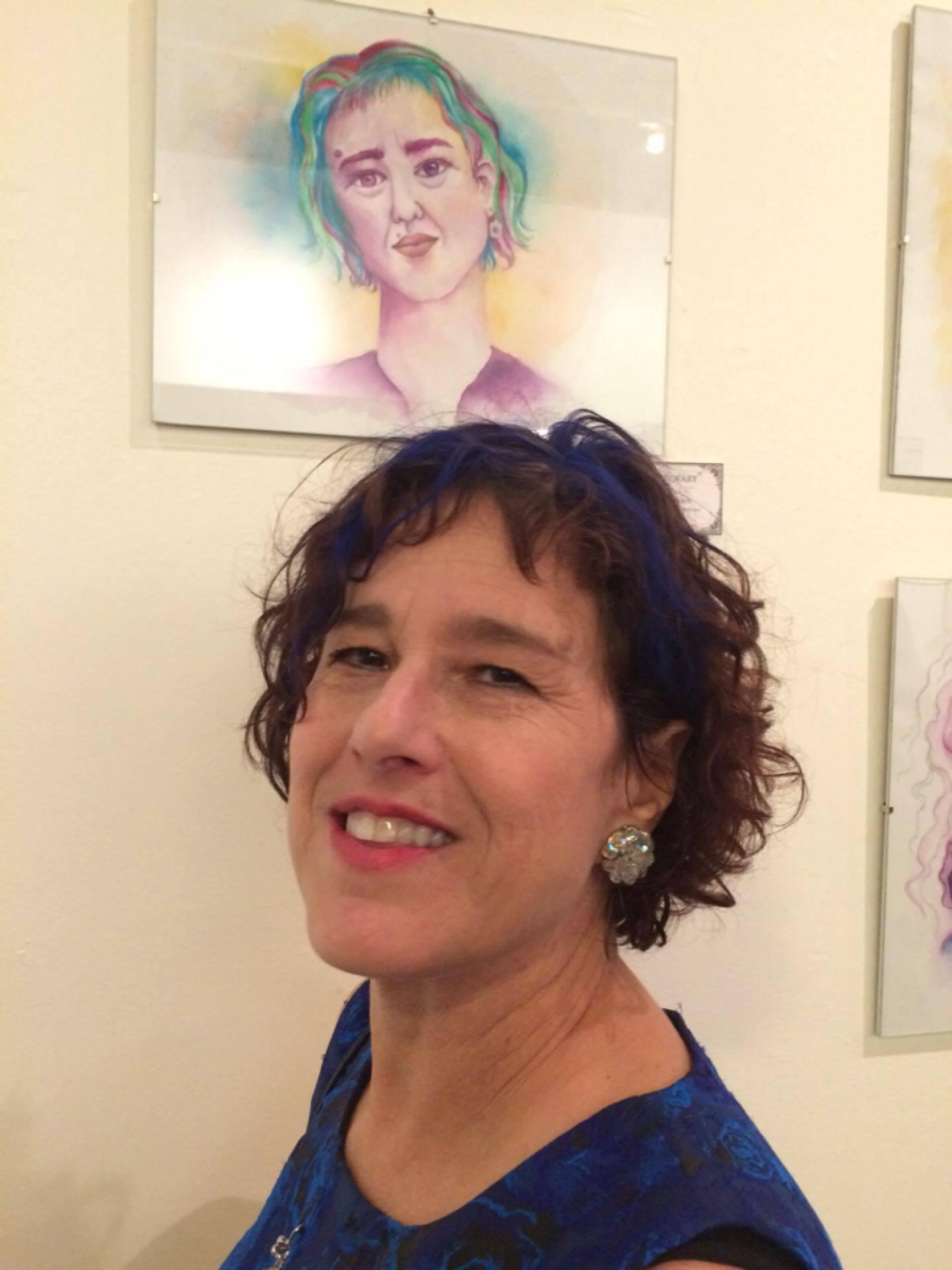 Miki Berman in front of her self-portrait