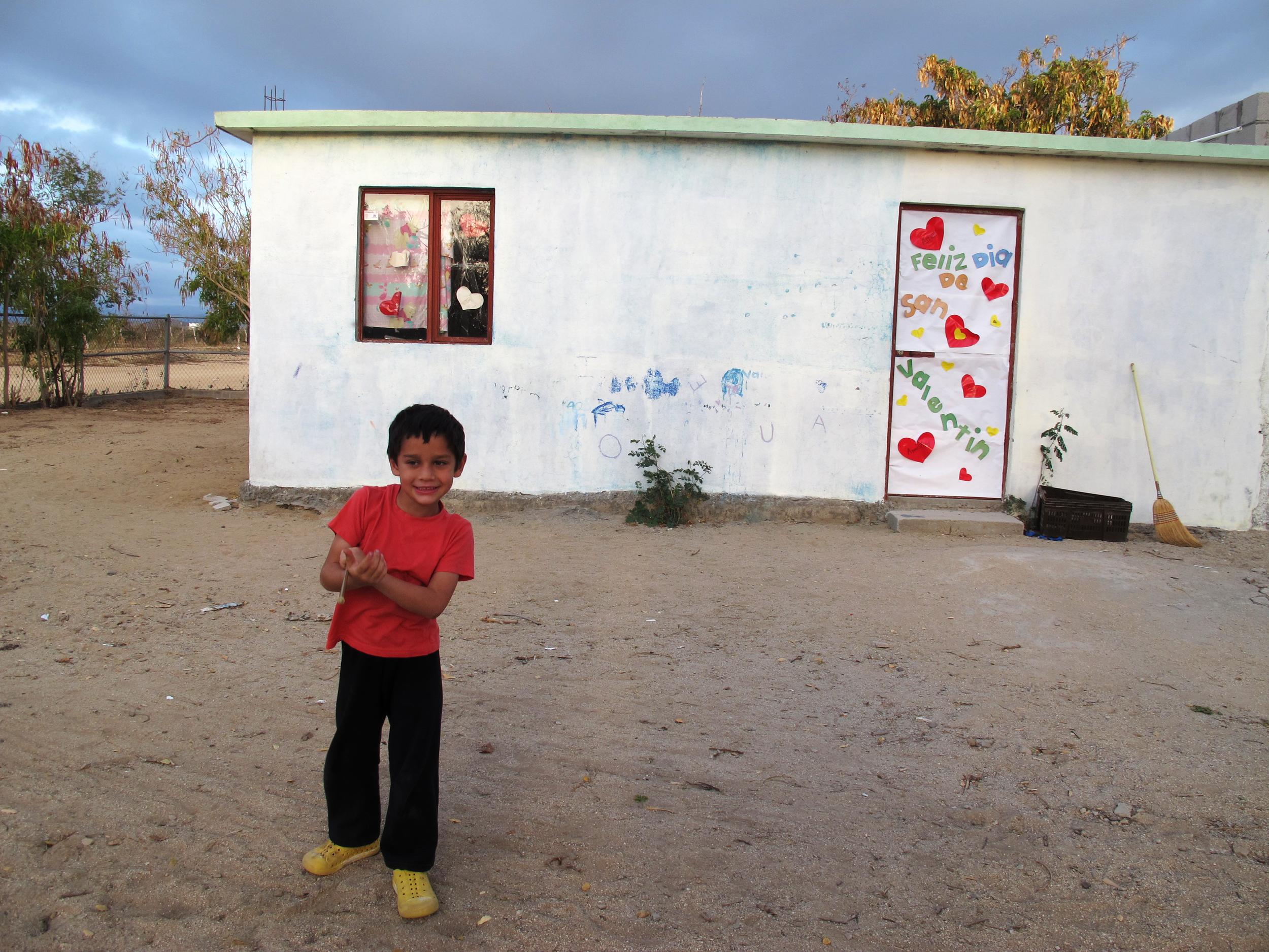Emilio in front of school