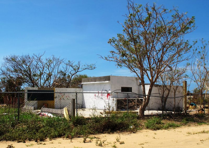 The other side of the school, after Odile removed its roof and wall.
