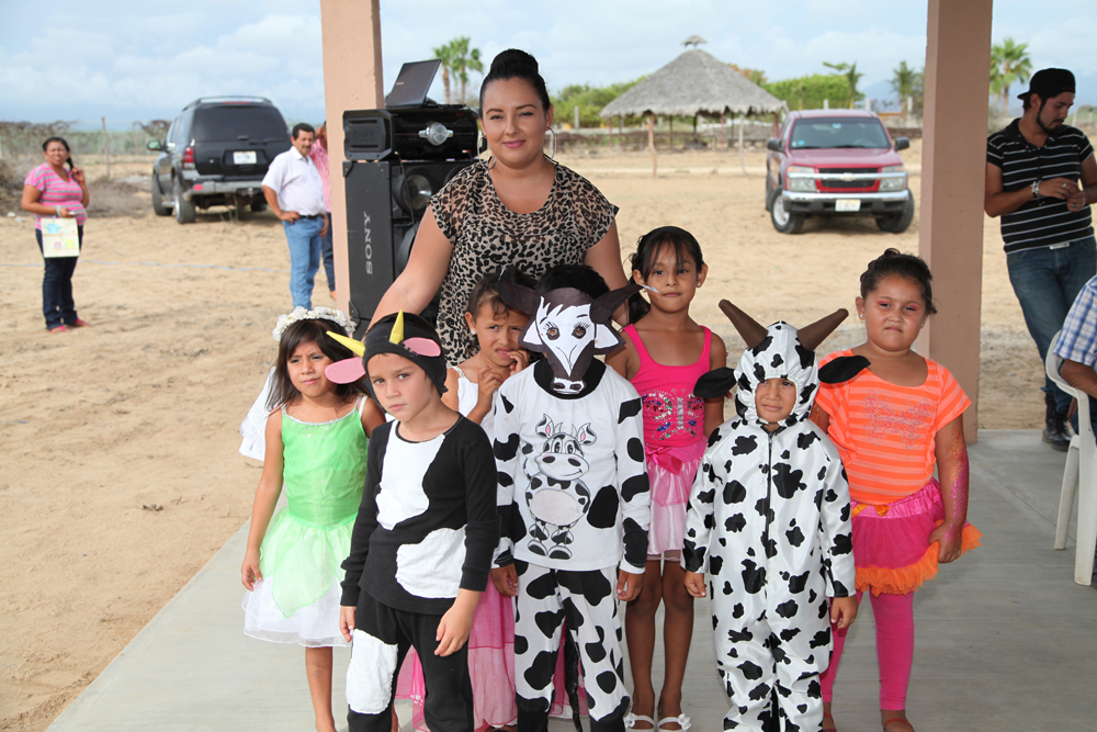 The kids in their performance costumes with Veronica, their third teacher of the year. Butterflies and cows. Emilio (left) is wearing the cow costume. The first costume I have made by hand as a mom.