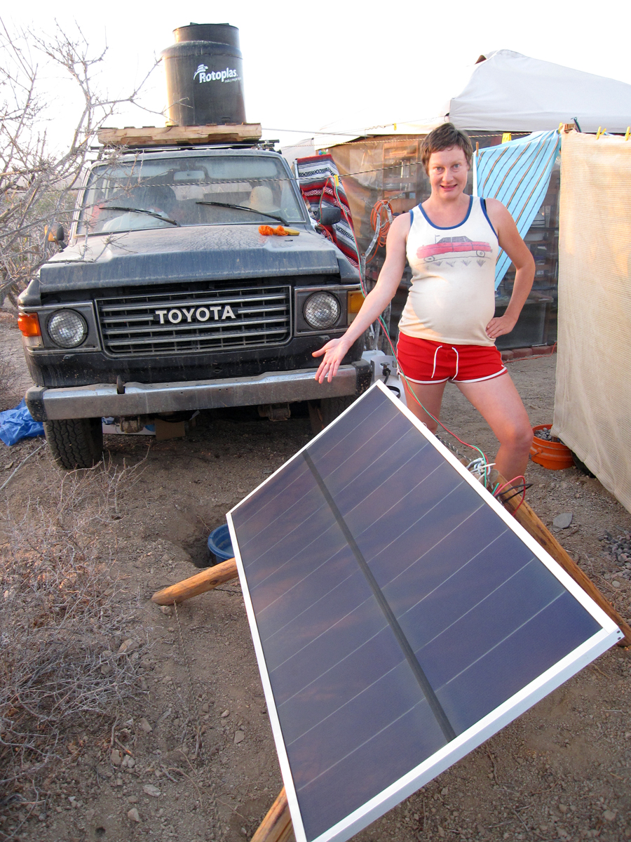 Showing off our solar panel at our camp.