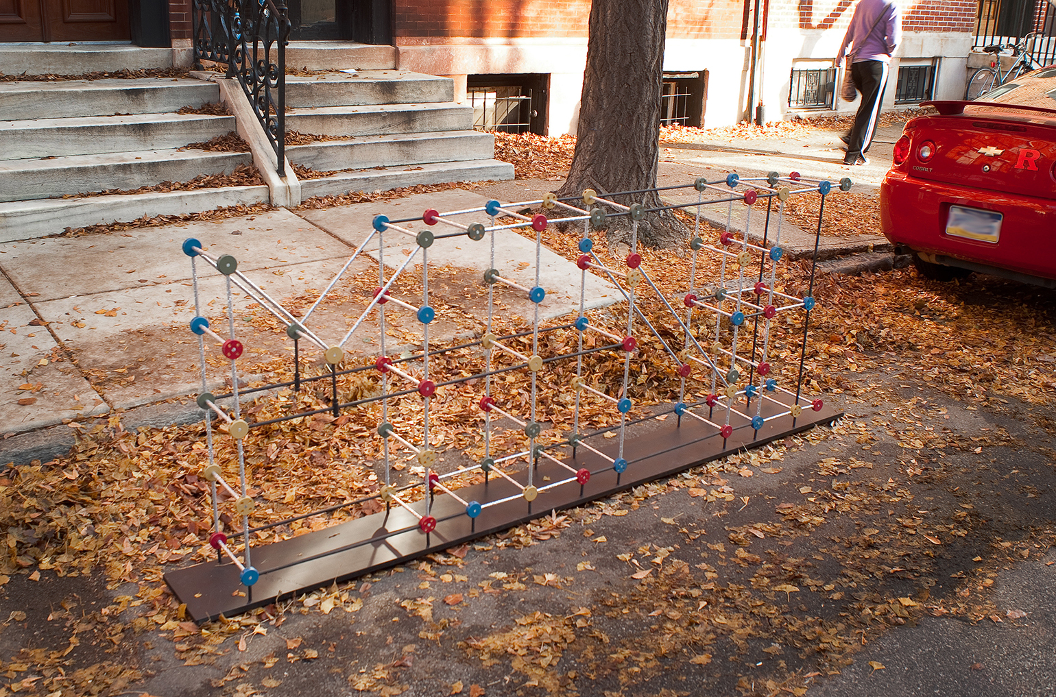 """Mine  , 2011  (street installation) homemade tinker toys, glitter, wood, acrylic 34"""" x 10"""" x 7.5' © Brent Wahl  From the   Space Savers Project  , 2100 block of Pine Street, Philadelphia, PA"""