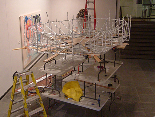 Installation of     the large version of     Stadium  , 2006  aluminum foil, wire, coal, glitter, wood, and nylon 12 x 9 x 3 feet © Brent Wahl  Predecessor  of  The Most Fearful and Merciful Thing in the World , 2006