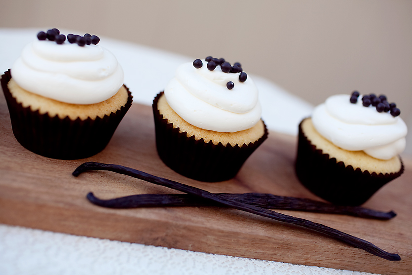 VANILLA  our signature vanilla cupcake topped with vanilla buttercream and dark chocolate dragees