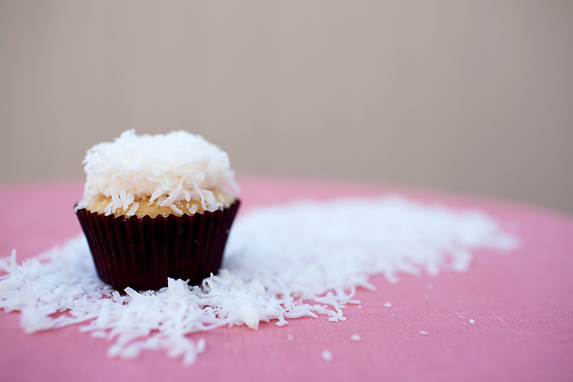 COCONUT DELIGHT  coconut cupcake topped with buttercream and coconut shavings
