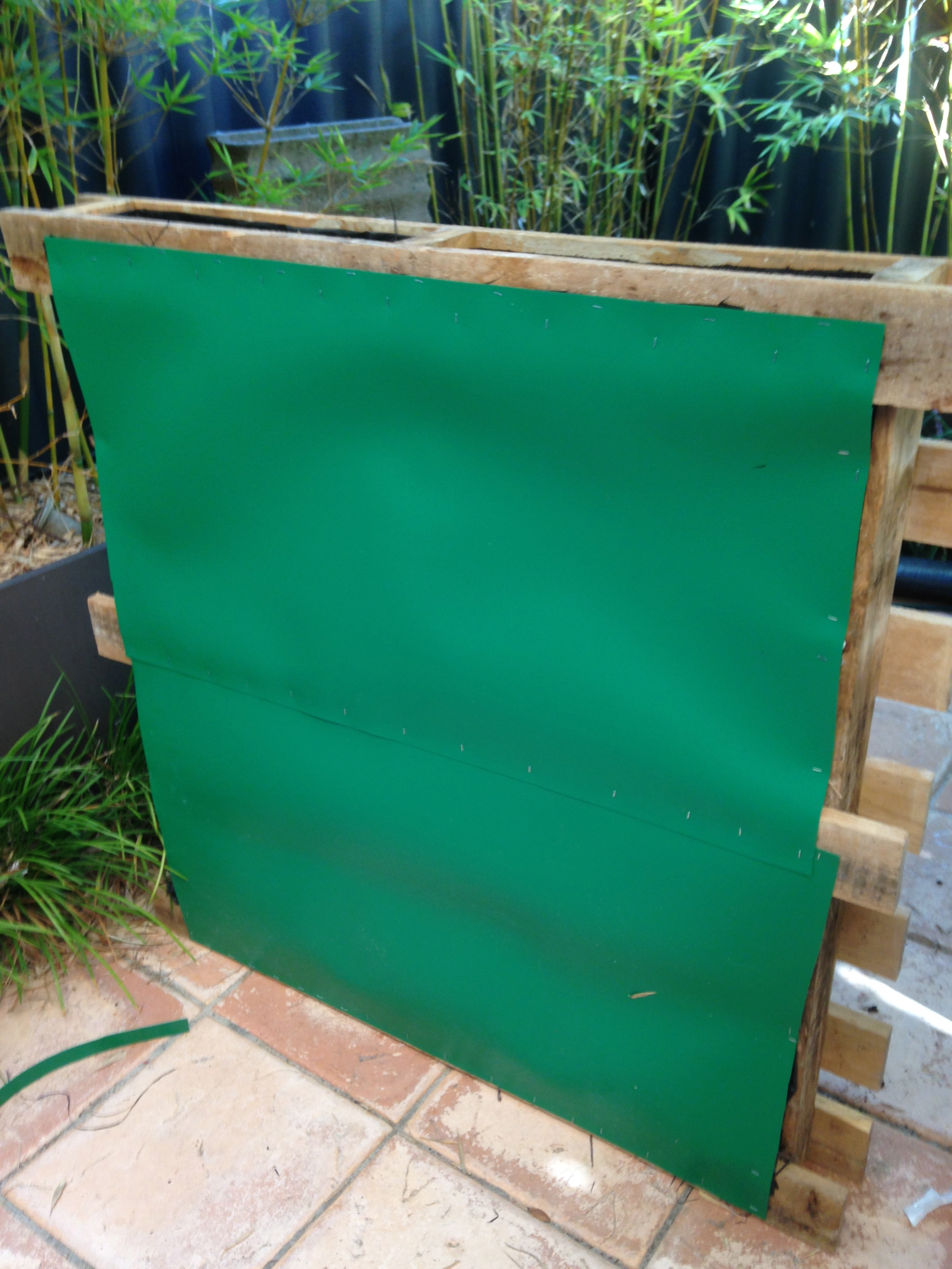 My waterproof backing is some root barrier that I had in the garage.  Blueboard would work just as well, but you will need to nail it on.