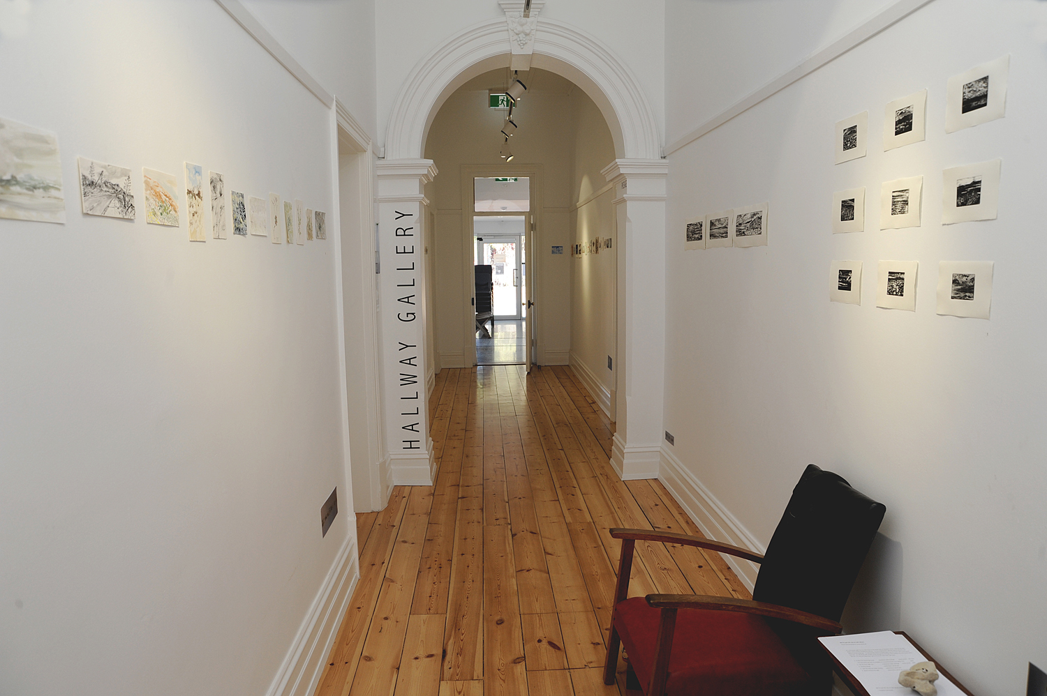 Etchings and postcard sketches lining the Hallway Gallery at Sauerbier House, Port Noarlunga