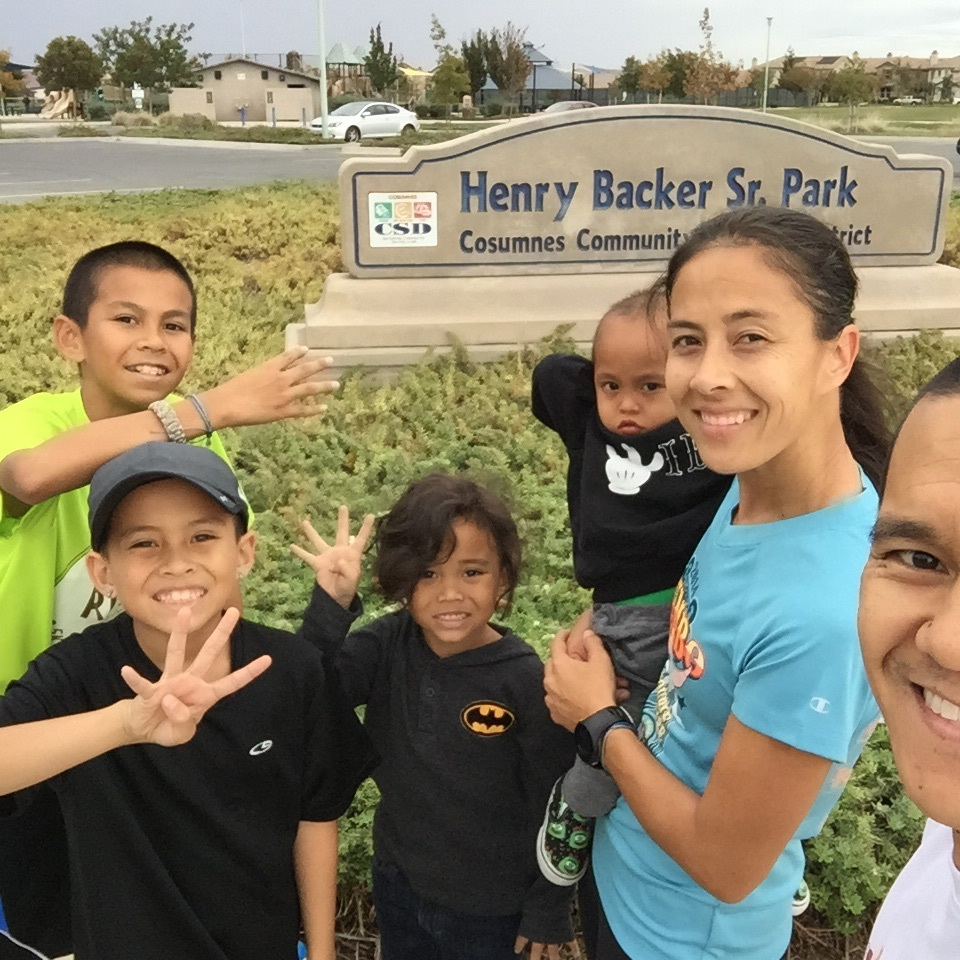 Still smiling. Soon after this picture was taken, raindrops started to fall. The boys first time running in the rain with 4.5 miles left to get home!
