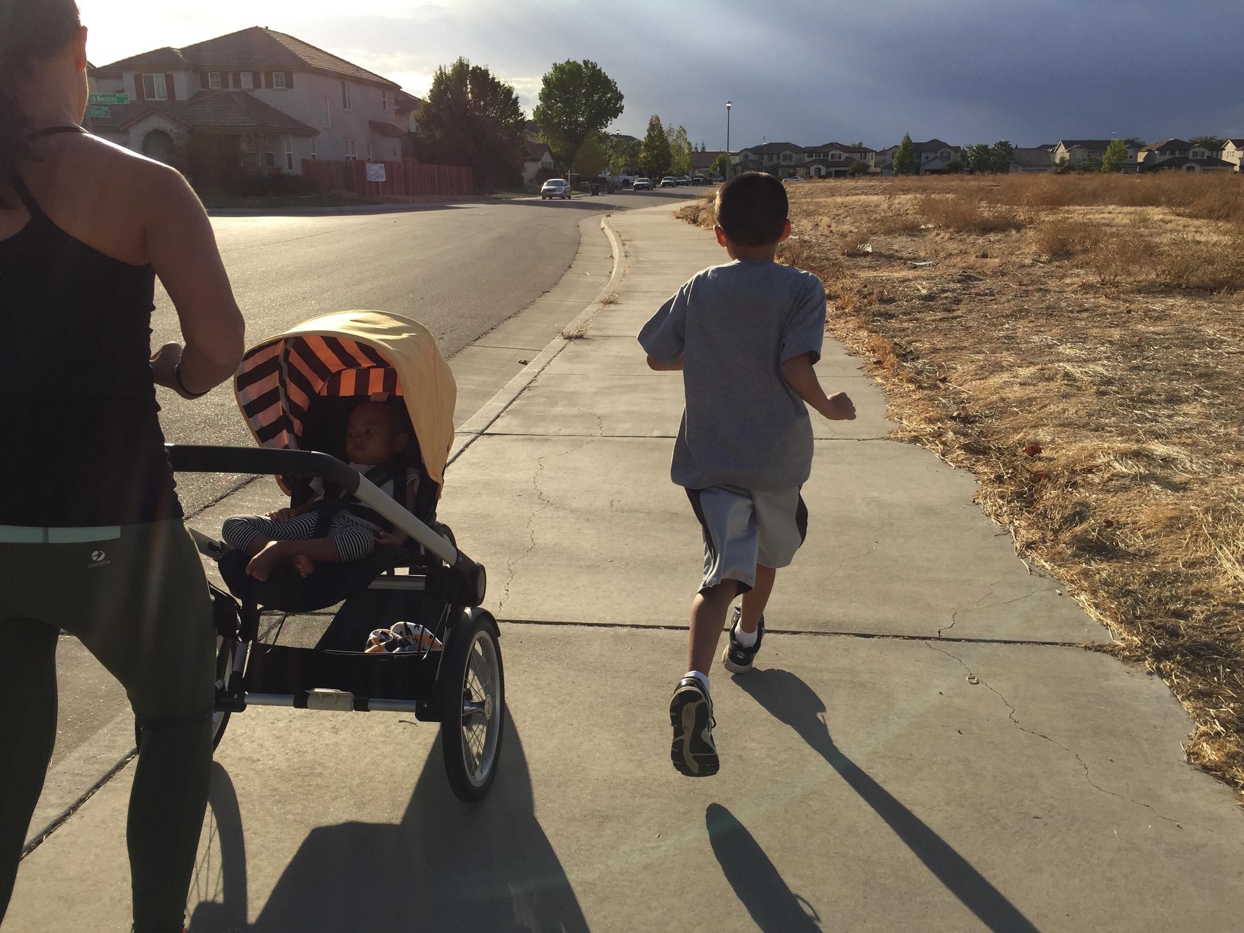 Racing the 9 year old to the stop sign which ended up being 200m. He won, I had the stroller to push. Extra work!